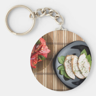 Сhicken meat decorated with basil and tomato salad keychain