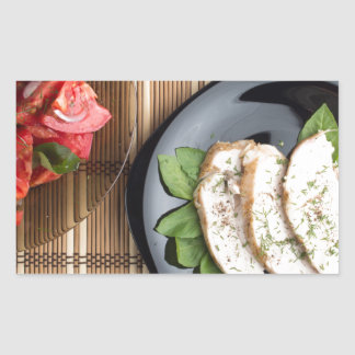Сhicken meat decorated with basil and tomato salad rectangular sticker
