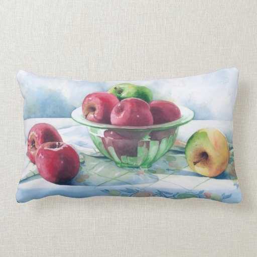 0002 manzanas en almohada verde del bol de vidrio