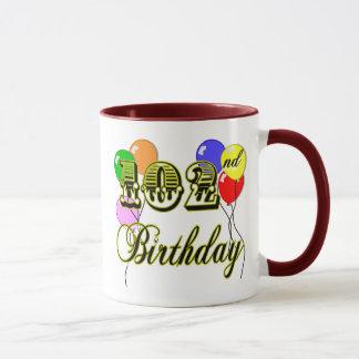 102nd Birthday with Balloons Mug