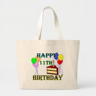11mo cumpleaños feliz con la torta, los globos y l bolsa tela grande