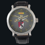 "11th ACR Crossed Sabers Ribbon &amp; Patch Watch<br><div class=""desc"">Features the photo-real brass Cavalry Crossed Sabers insignia,  Vietnam Sevice Ribbon,  and Blackhorse Patch on a dark gray gradient face with gold numbers.</div>"