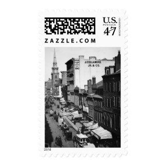 1859:  Traffic and shops on Washington Street Stamp