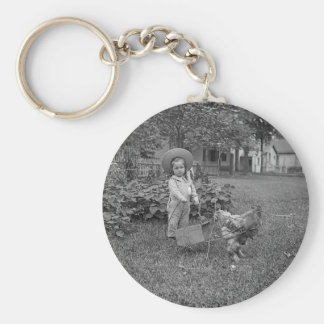 1880's Adorable Girl and Rooster Cart in Garden Keychain