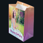 "18th birthday custom photo gift bag purple<br><div class=""desc"">A giftbag for a eighteen years old girl,  with the number 18 and the text Happy Birthday in purple. An ultra violet,  pink and peach colored pastel backdrop. Template for your photo of the birthday girl and age.</div>"