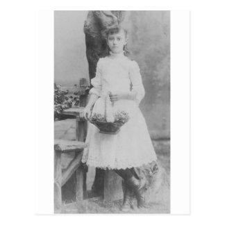 1900's Girl holding basket Postcard