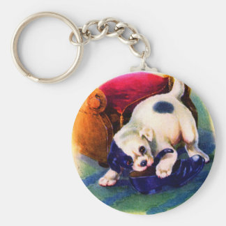 1930s adorable puppy no. 3 chewing on a shoe keychain