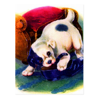 1930s adorable puppy no. 3 chewing on a shoe postcard