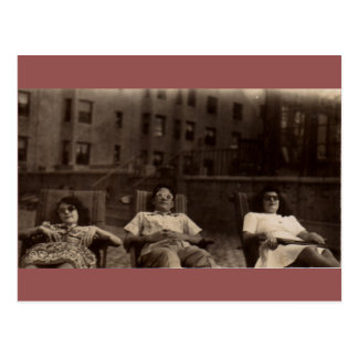 1940s three people relaxing on the roof postcard