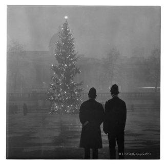 1948: Two policemen regard Christmas Tree Ceramic Tile
