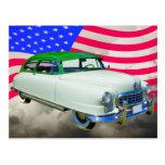 1950 embajador de Nash Car y bandera americana Postales