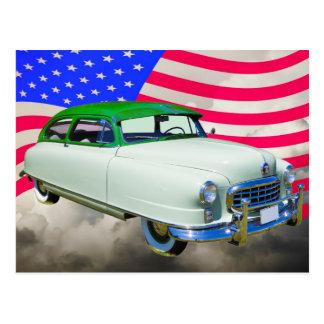 1950 embajador de Nash Car y bandera americana Postal