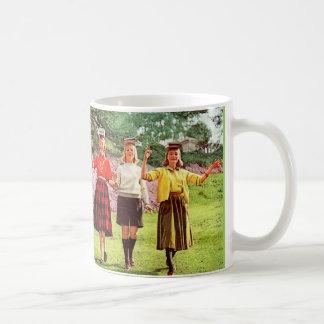 1960 teenage girls with books on their heads coffee mug