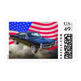 1967 Pontiac GTO y bandera americana Estampillas