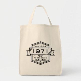 1971 envejecido a la perfección bolsas de mano
