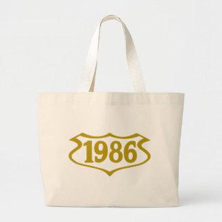 1986-shield.png large tote bag