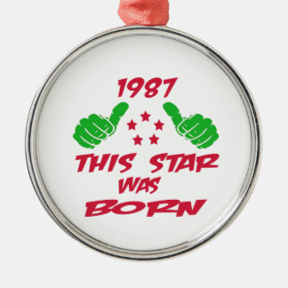 1987 this star was born round metal christmas ornament