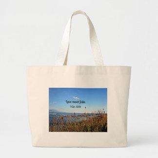 1 Corinthians 13:8 Love never fails. Large Tote Bag