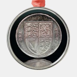 £ 1 METAL ORNAMENT