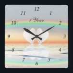 "1st Anniversary Paper Hearts Square Wall Clock<br><div class=""desc"">Two paper hearts floating on the water under a rainbow. Customizable text says &quot;1 Year&quot;.</div>"