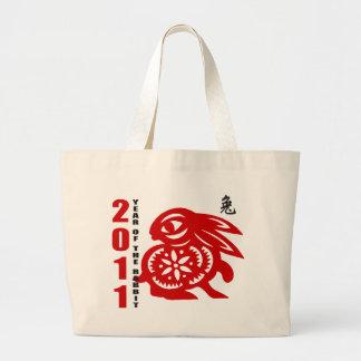 2011 años del corte del papel chino del conejo bolsas de mano