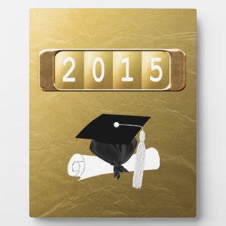 2015, casquillo y diploma, oro y negro placas con fotos
