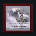 "25th Ordination Anniversary Cross Host Gift Box<br><div class=""desc"">Celebrate a 25th Ordination Anniversary with this beautiful silver satin background and cross with red details. A paten of hosts is seen behind the name and 25th Year. Customize with the name for a truly personal Ordination Anniversary Gift! Party supplies and customizable items are available for a memorable celebration!</div>"