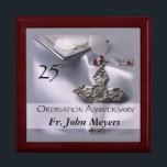 """25th Ordination Anniversary Cross Host Gift Box<br><div class=""""desc"""">Celebrate a 25th Ordination Anniversary with this beautiful silver satin background and cross with red details. A paten of hosts is seen behind the name and 25th Year. Customize with the name for a truly personal Ordination Anniversary Gift! Party supplies and customizable items are available for a memorable celebration!</div>"""