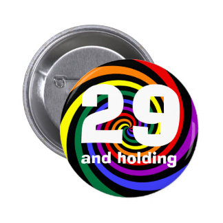29 and holding 2 inch round button