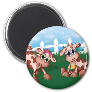 2 Baby Cows grazing on a hill side pasture 2 Inch Round Magnet