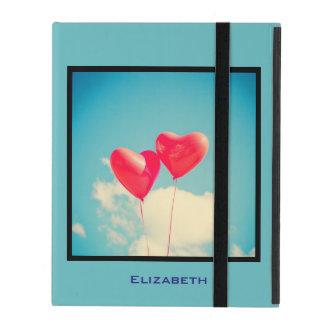 2 Bright Red Heart Shaped balloons Floating Upward iPad Covers