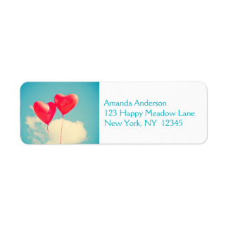 2 Bright Red Heart Shaped balloons Floating Upward Label