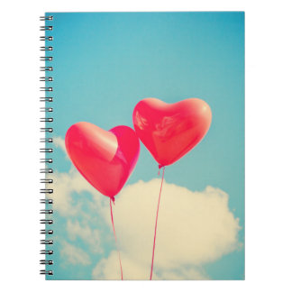 2 Bright Red Heart Shaped balloons Floating Upward Notebook