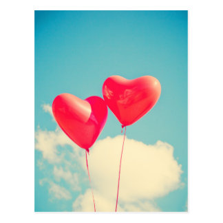 2 Bright Red Heart Shaped balloons Floating Upward Postcard
