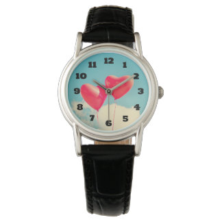 2 Bright Red Heart Shaped balloons Floating Upward Watch
