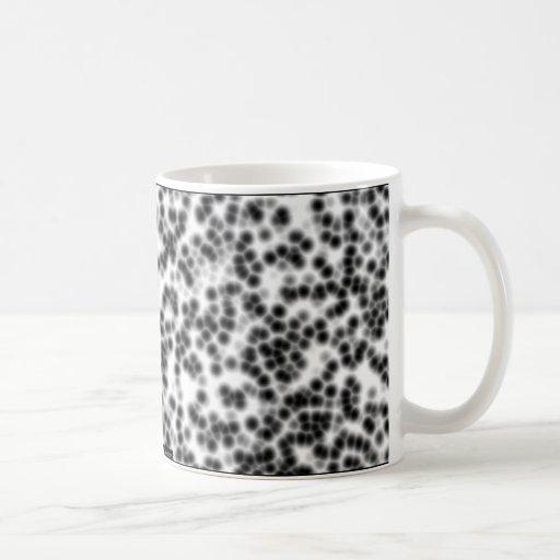 2 celulares taza de café