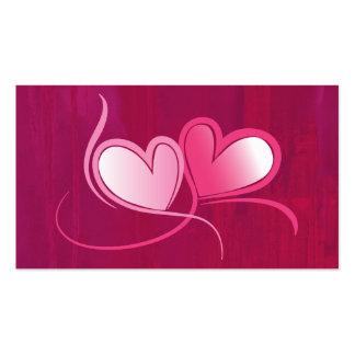 2 corazones que bailan en un fondo rosado de tarjetas de visita
