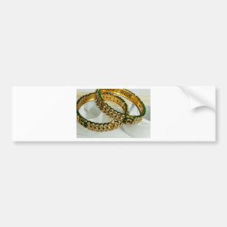 2 golden bracelets with embedded stones car bumper sticker