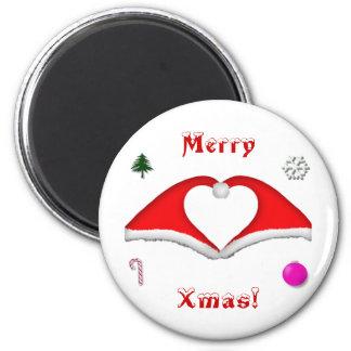 2 gorras de Navidad forman un corazón y otras deco Imán Redondo 5 Cm