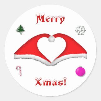 2 gorras de Navidad forman un corazón y otras Pegatina Redonda