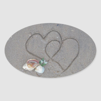 2 Hearts  in the sand with shells Oval Stickers