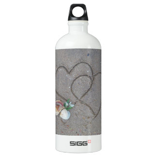 2 Hearts  in the sand with shells Water Bottle