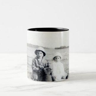 2 kids beach and a teddy bear mug
