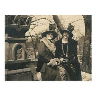 2 ladies with hats with feathers postcard