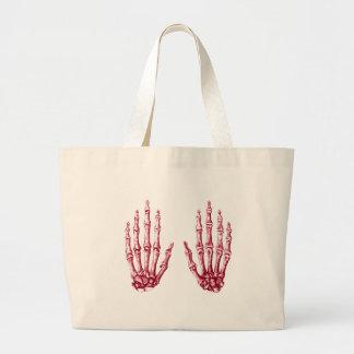 2 manos suben rojo bolsa lienzo