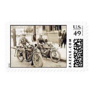 2 men riding motorcycles postage