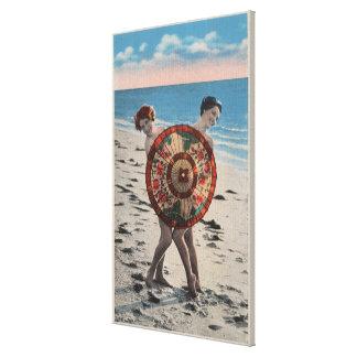 2 mujeres que toman el sol y paraguas asiático, la impresiones en lona