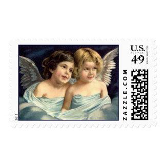 2 pequeños ángeles cubrieron en el azul - sello