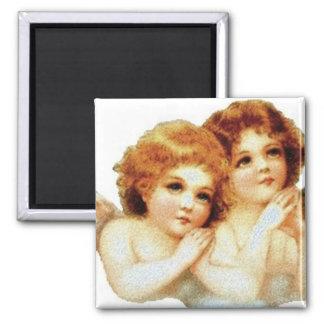 2 pequeños ángeles que ruegan - imán