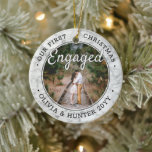 """2 Photo Our First Christmas Engaged Faux Marble Ceramic Ornament<br><div class=""""desc"""">Celebrate the joyful 1st holiday of your engagement with this custom 2 photo """"Our First Christmas Engaged"""" round faux marble ceramic ornament. All text and images on this template are simple to personalize and can be different or the same on front and back.(IMAGE & TEXT DESIGN TIPS: 1) To adjust...</div>"""
